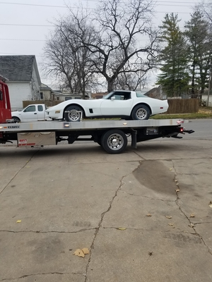Car on flatbed truck